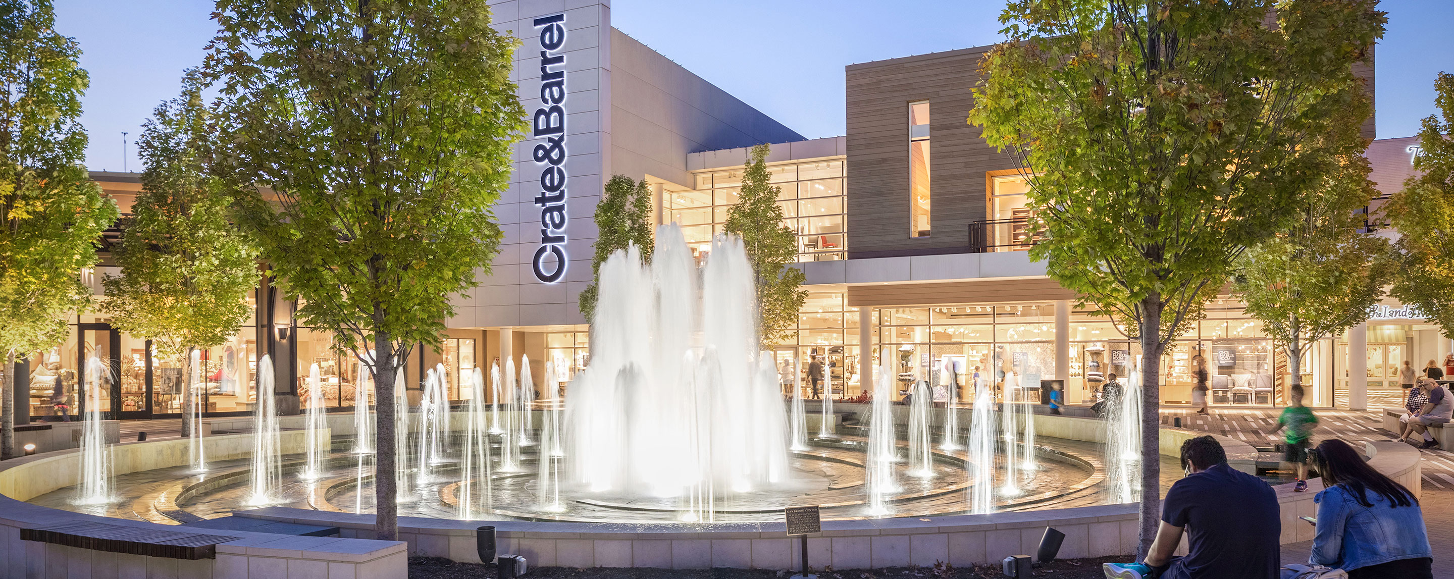 Outside of a Crate & Barrel at a GGP property, a glowing fountain is a good resting spot for shoppers.